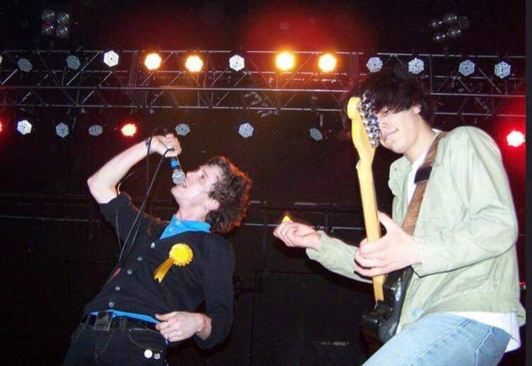 Sam Mehran playing guitar