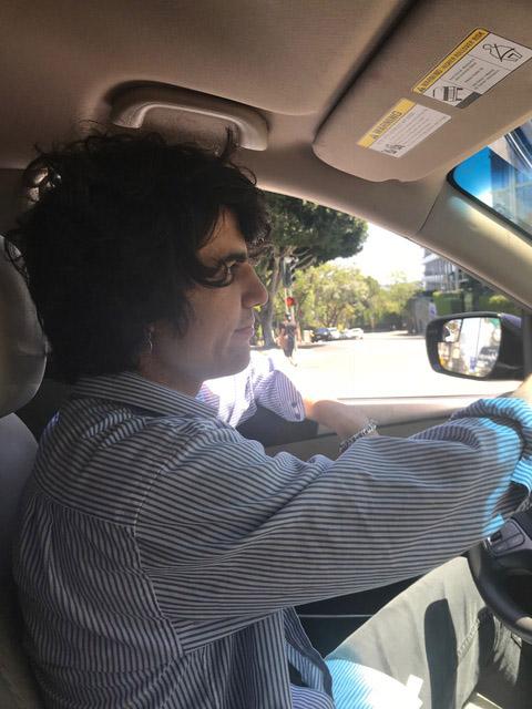 Sam Mehran Driving a Car